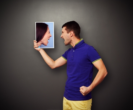 quarrel between the man and the woman over dark background