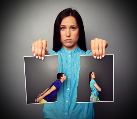 sorrowfully: concept photo of sad woman broking off relationship Stock Photo