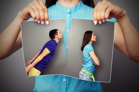 disrupt: woman lacerating photo of young couple in quarrel