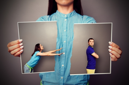 young woman stretching her hands to resentful man photo