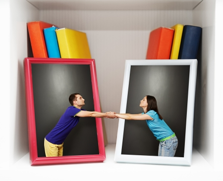 romantic photo of young couple. boy and girl reaching out to each other from pictures photo