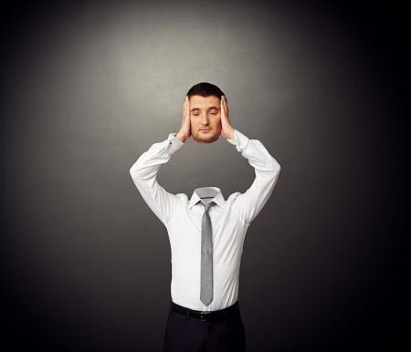 unworried: man in formal wear holding his sleeping head in hands