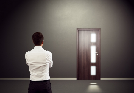 way of thinking: businessman looking at the door  Stock Photo