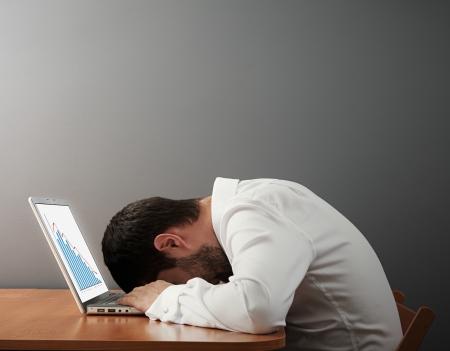 slump: businessman sleeping on the keyboard