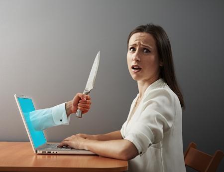 cruelty: young woman afraid virtual maniacs Stock Photo