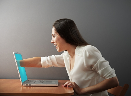 young woman has an internet addiction photo