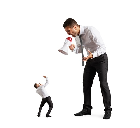 the boss: big boss screaming at the small businessman. isolated on white background Stock Photo