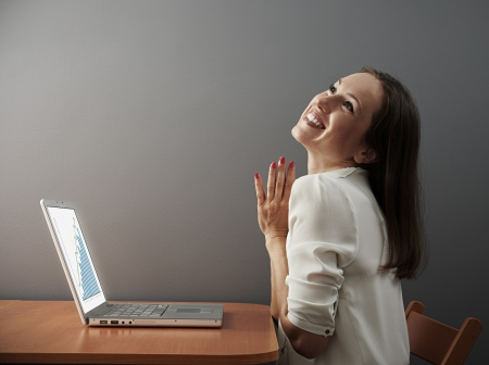 jovial young businesswoman with laptop