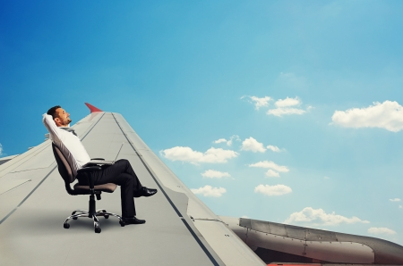 smiley businessman flying and resting photo