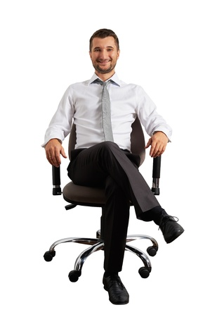successful businessman sitting on office chair and smiling. isolated on white background