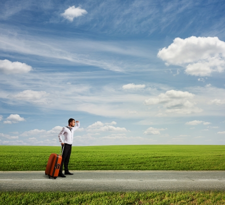 the long way to vacation. young businessman holding bag and looking forward photo