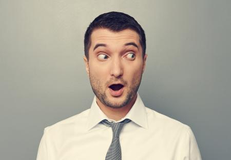 discredit: amazed businessman looking at something Stock Photo
