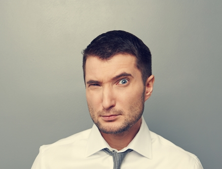 discredit: young caucasian businessman looking with suspicion  Stock Photo