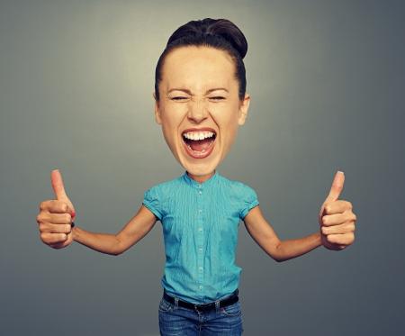 grosse tete: heureux fille crier avec la grosse t�te et big thumbs up