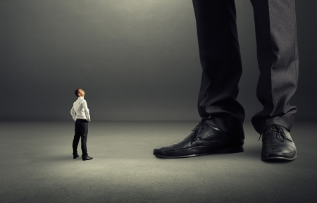 big shoes: small businessman looking at his big boss Stock Photo