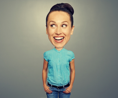 big teeth: laughing girl with big head over dark background Stock Photo