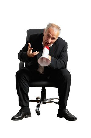 emotional senior businessman with megaphone. isolated on white background photo