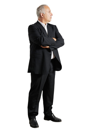 one senior adult man: businessman with crossed hands looking at something Stock Photo