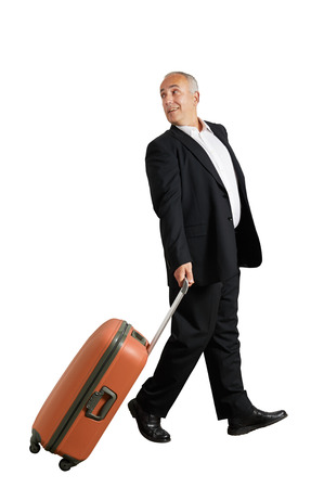 looking back: man with suitcase looking back and smiling. isolated on white background