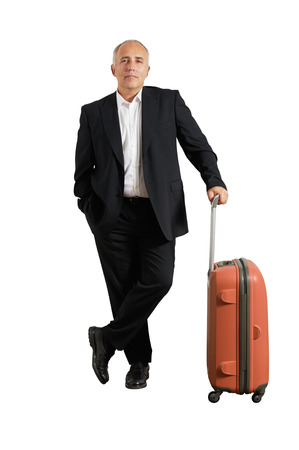 serious businessman: serious businessman with suitcase over white background