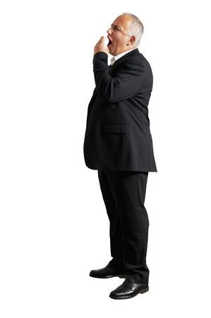 tiresome: full length photo of tired man over white