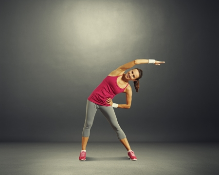 full-length photo of fitness woman over dark  Stock Photo - 22659554