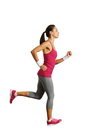 corrida: foto de cuerpo entero de una mujer corriendo en blanco Foto de archivo