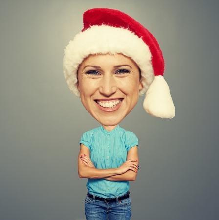 funny santa girl with big head looking at camera and smiling