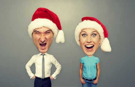 christmas photo of angry man and happy woman over grey background photo