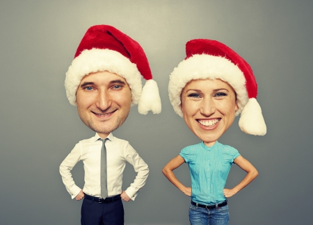 funny picture of christmas couple over grey background photo