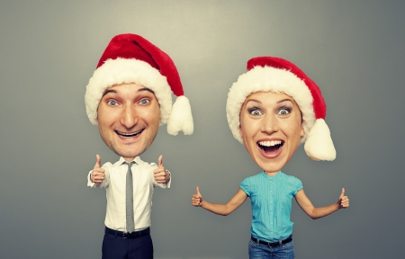 funny christmas picture of happy bighead couple over grey background photo