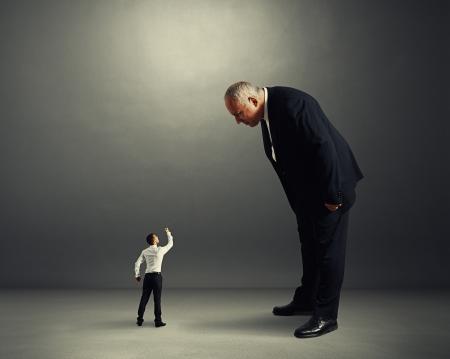 big and small: big boss good looking at small worker