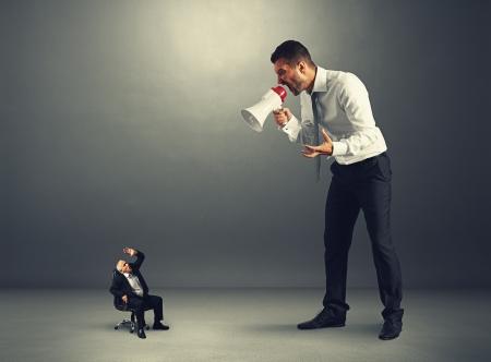 subordinate: young boss screaming at senior worker