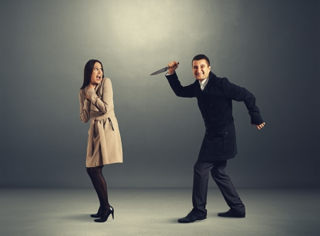 hysterics: startled woman and man with knife Stock Photo