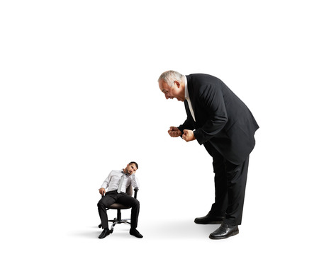 lazybones: big angry boss screaming at small lazy worker. isolated on white background