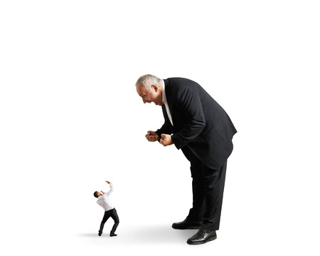big angry boss screaming at small startled worker. isolated on white background photo