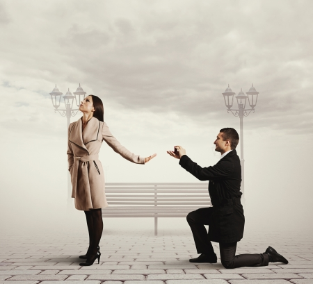 marriage proposal: smiley handsome man making proposal of marriage the woman Stock Photo