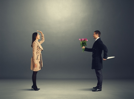 happy young woman waiting man with flowers and knife photo