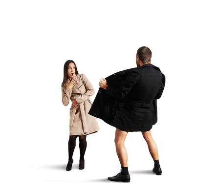 frightened woman looking at exhibitionist. isolated on white background Stock Photo