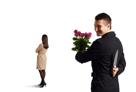 insidious: insidious man with knife standing behind young woman. isolated on white background Stock Photo