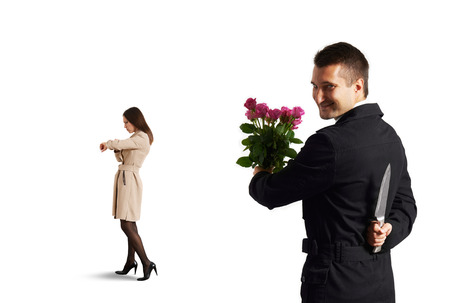 meanness: perfidious man with knife going to metting  Stock Photo