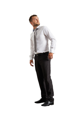 startled: startled businessman looking up. isolated on white background