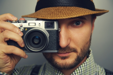 portrait of stylish handsome man with camera Stock Photo - 24038197