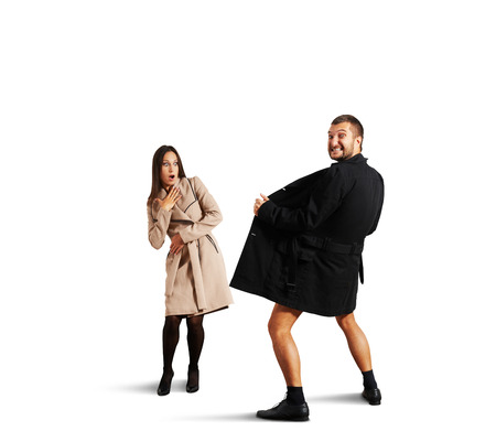 shocked woman looking at crazy man in coat. isolated on white background