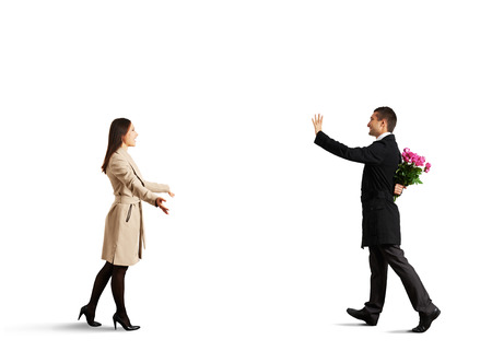 happy couple going to meet each other. isolated on white background photo