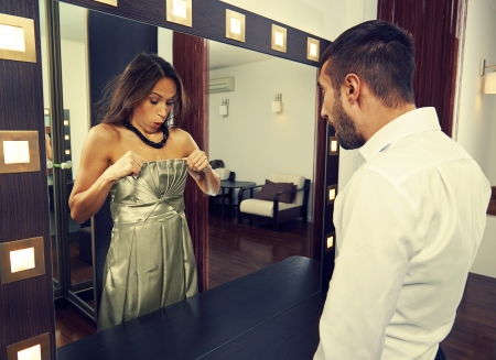 looking in mirror: amazed man looking at woman in the mirror