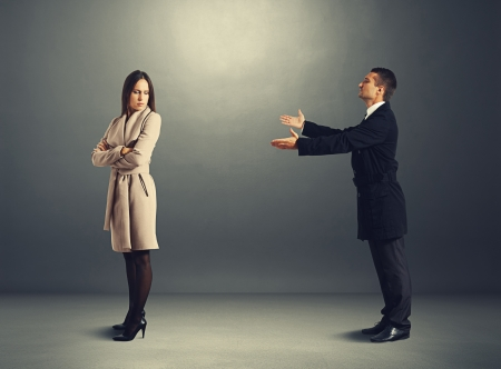 supplication: young man apologizing to offended woman
