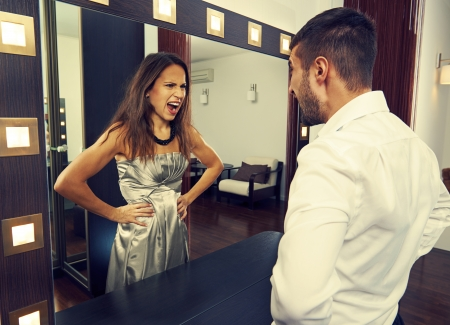 angry man shouting at mad woman in the mirror