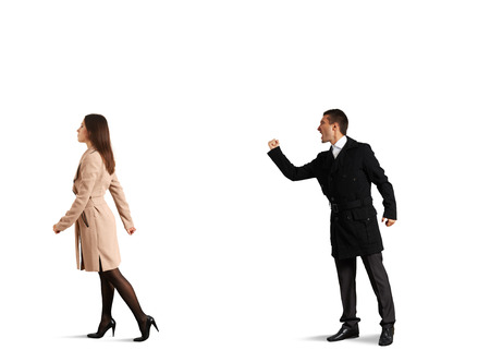 betrayal: aggressive man yelling at the outgoing woman. isolated on white background