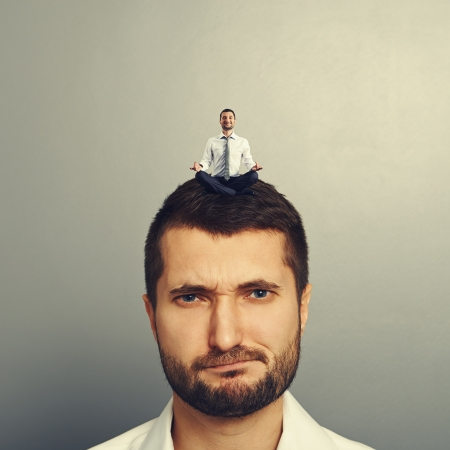 sponger: portrait of dissatisfied man with small man on the head